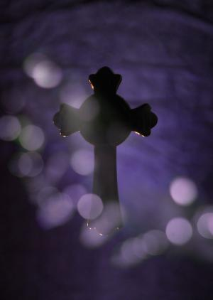 Celtic Cross Silhouetted with Purple Background
